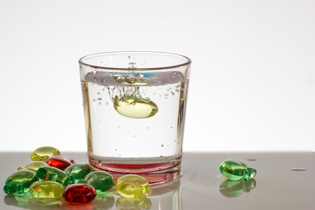 bubble acid: a glass of water with bubbles and splashes Stock Photo