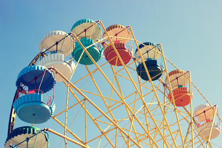 ferriswheel: Ferris wheel-yellow with multi-colored booths on a white background Stock Photo