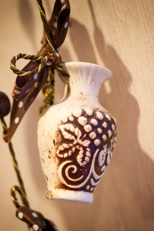 the image vase ceramic souvenir on the rope Stock Photo