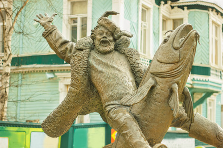 herder: the image Russian bronze sculpture man riding fish Stock Photo