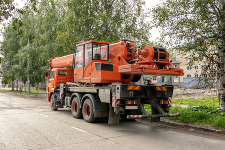 pneumatic tyres: the image auto crane parked on the roadside Stock Photo