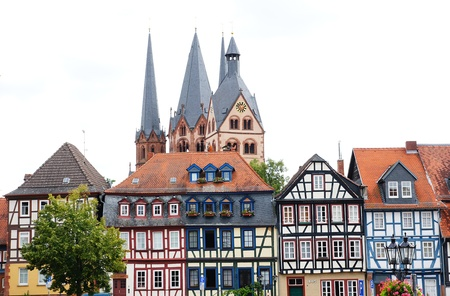 half timbered: Half-timbered houses and St  Mary s Church of Gelnhausen Stock Photo