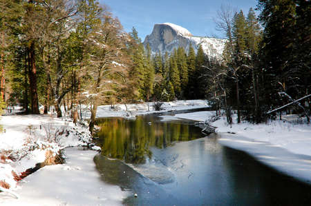 Yosemite with half dome covered in snow
