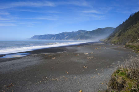 Black sand beach on the Oregon Coast photo