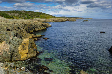 Rocky Shoreline with clear green and blue water. Stock Photo - 6571698