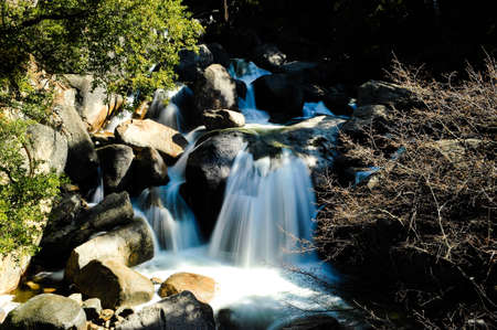 shutter: A cascading water fall shot at slow shutter speed Stock Photo