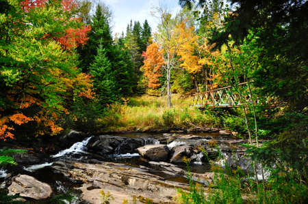 Fall colors and stream with metal bridge Stock Photo