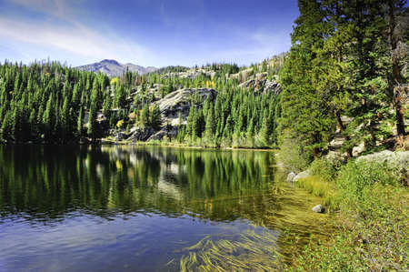 bear lake: Trees reflecting in Bear Lake, Rocky Mountain National Park Stock Photo