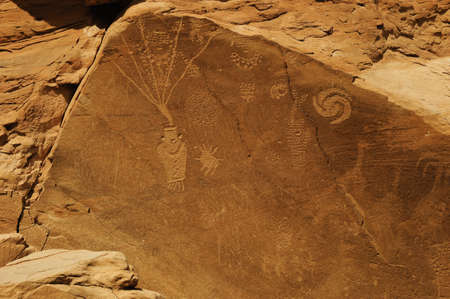 Petroglyphs on a red rock in Utah Stock Photo