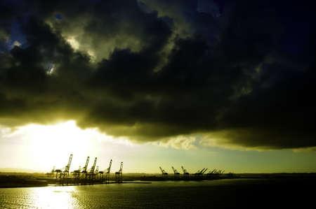 colon panama: Cranes at the port of colon, panama, at sunrise Stock Photo