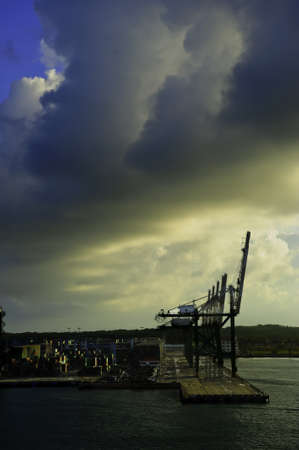 Cranes and shipping containers at the Port of Colon Panama at sunrise Stock Photo - 9875949