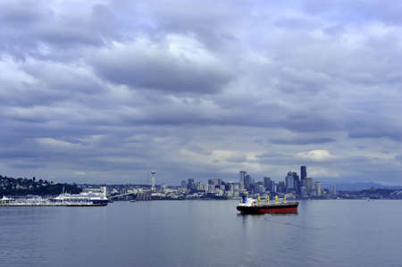 Seattle Cityscape with a red container ship photo