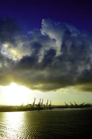 colon panama: Container cranes at sunrise at the Port of Colon Panama