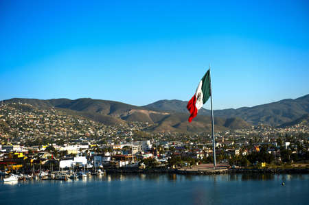 mexican flag: A large Mexican flag flying at the Port of Ensenada  Stock Photo