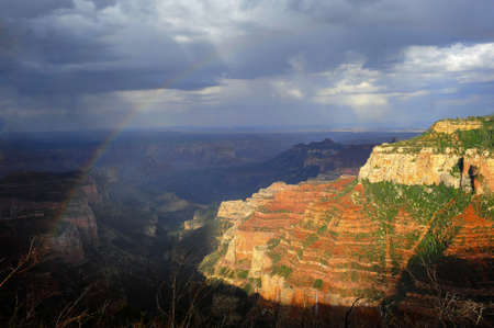showers: Rainbow and rain showers over the North Rim of the Grand Canyon