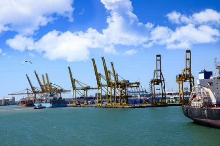 The busy Port of Barcelona Spain and shipping conainers  photo