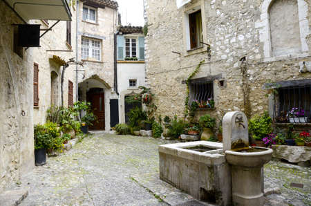 vence: Water fountain in the medievel town of Saint Paul De Vence in France Stock Photo