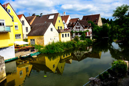 middle ages boat: The river Wornitz flowing through the town of Harburg, Germany. Stock Photo