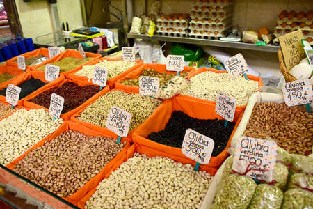 Farmers market in spain selling dried beans.