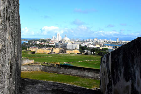 View of Ssn Juan, Puerto Rico skyline from the wall of Fort San Cristobal. Stock Photo