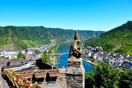 Helmeted Lion statue and view of the town of Cochem and the Mozel River.
