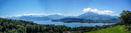 blue widescreen widescreen: Panorama of Vierwaldstattersee and Lucerne Stock Photo