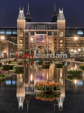 Floating tulips and reflection of Rijksmuseum Amsterdam at night Editorial