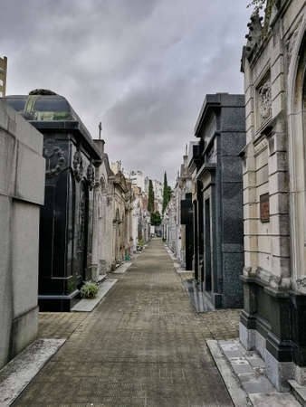 street of tombstone buildings in argentinian cemetery 写真素材