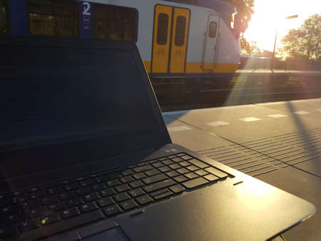 Working on laptop while waiting on platform for train, maximize productivity