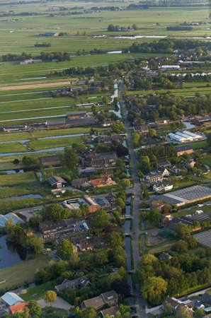 Aerial view of dutch farmland village along rural road