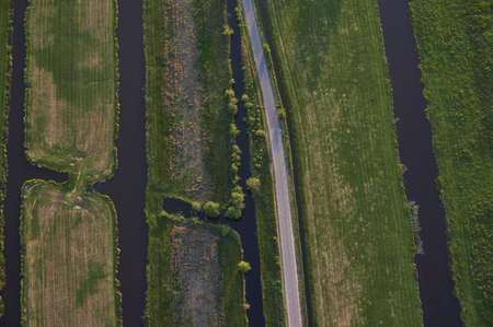 Aerial view of road leading through peat excavation meadow landscape in the netherlands Foto de archivo