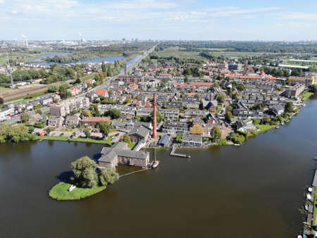 Aerial of historic steam pump station with pipe in Halfweg, the Netherlands