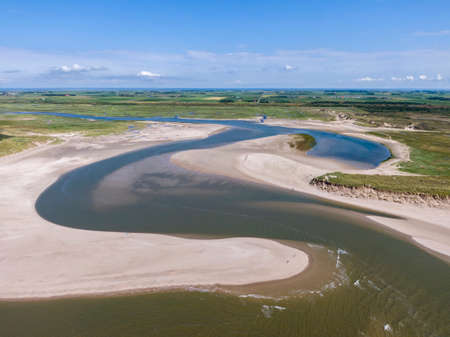 Aerial of the slufter national park with water inlet in the dunes of dutch island Texel