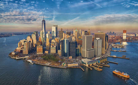 Aerial view of the south tip of manhattan with new york city financial district helicopter view during golden hour Stock Photo