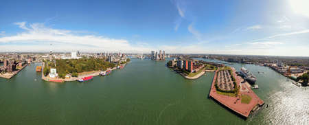 High resolution aerial panorama of Rotterdam with harbor and skyline or modern residential towers, euromast and Erasmus bridge