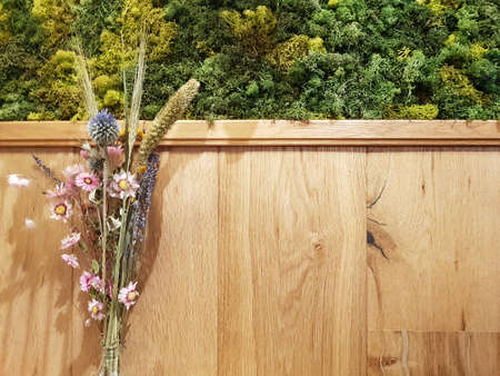 Wooden wall with flowers background with copy space on the right for wishing card concept