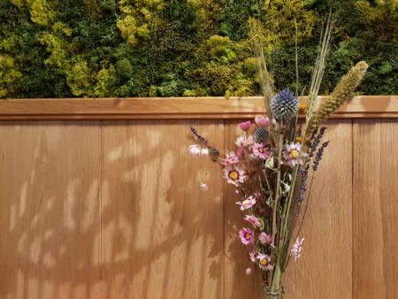 Wooden wall with flowers background with copy space on the left for wishing card concept