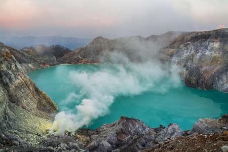Blue sulfuric acid lake or Mount Ijen volcano with poison smoke on East Java, Indonesia