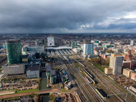 Aerial of the Utrecht central train station with office buildings and transit oriented development