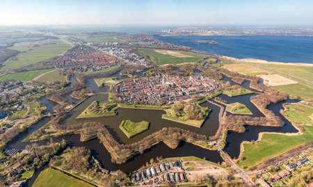 Super high resolution aerial image of the medieval Naarden Fortress village in the Netherlands with defense walls and canals