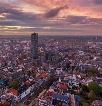 Aerial of Utrecht historic city center with the Dom church during impressive sunset with fire color clouds 版權商用圖片