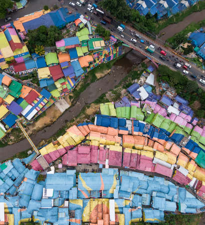 Top down aerial view of colorful rainbow village Jodipan in the city of Malang, on East Java, Indonesia