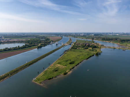 Aerial view on water sluice complex and water bypass in the Lek river in the Netherlands