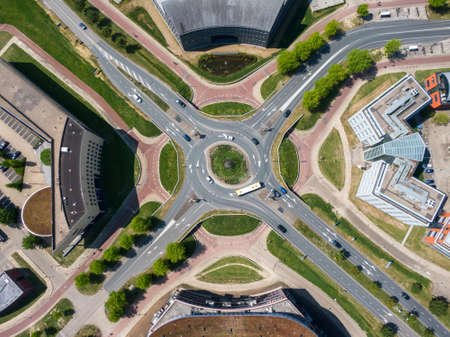 Top down aerial view of multi level turbo roundabout with road and cycle lanes in Houten, the Netherlands. Safe infrastructure solution for busy traffic intersection.