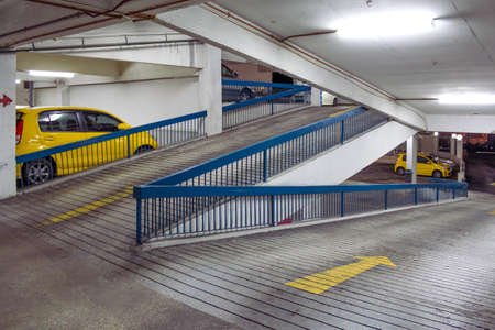 two car garage: Multilevel car garage with two identical yellow cars. Stock Photo