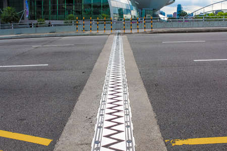 expanding: Sawtooth expansion joint on a modern bridge. Stock Photo