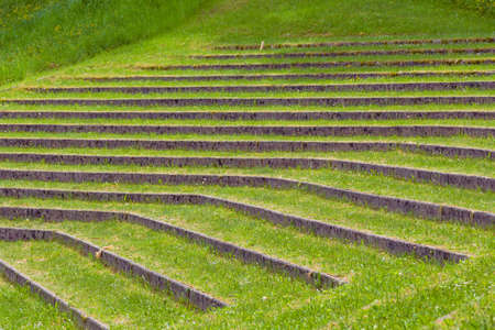 plurality: Plurality of layers overgrown with grass in old summer theater.