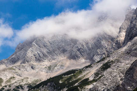 Mountain rocks covered with white clouds in the morning.