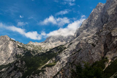 ceska: Mountain rocks covered with white clouds in the morning.