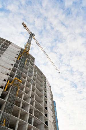 crane tower: concrete building construction with crane